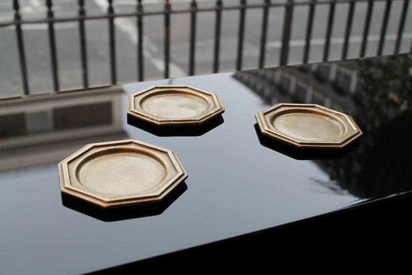Angular brass castor cups