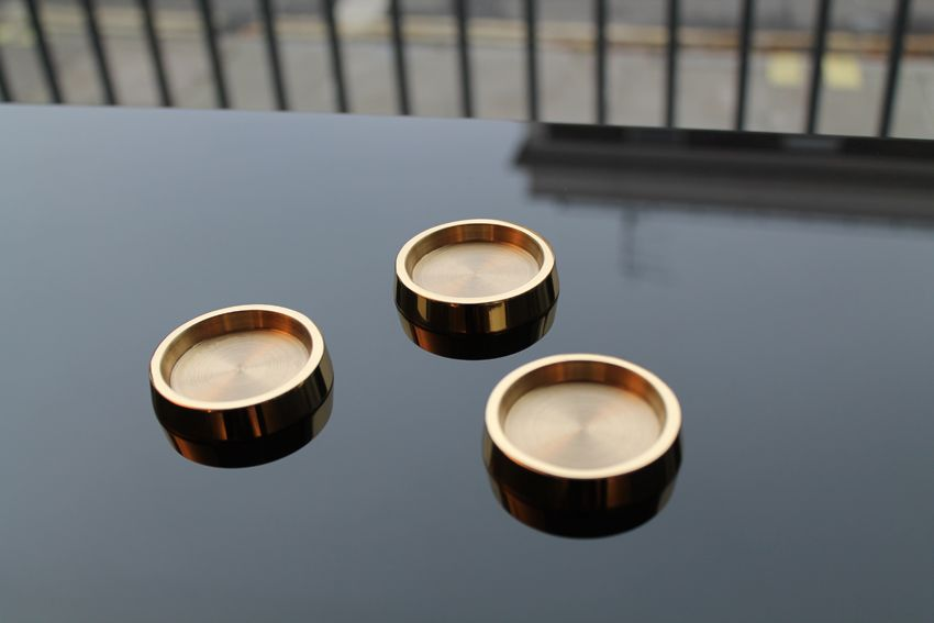 Very small brass castor cups