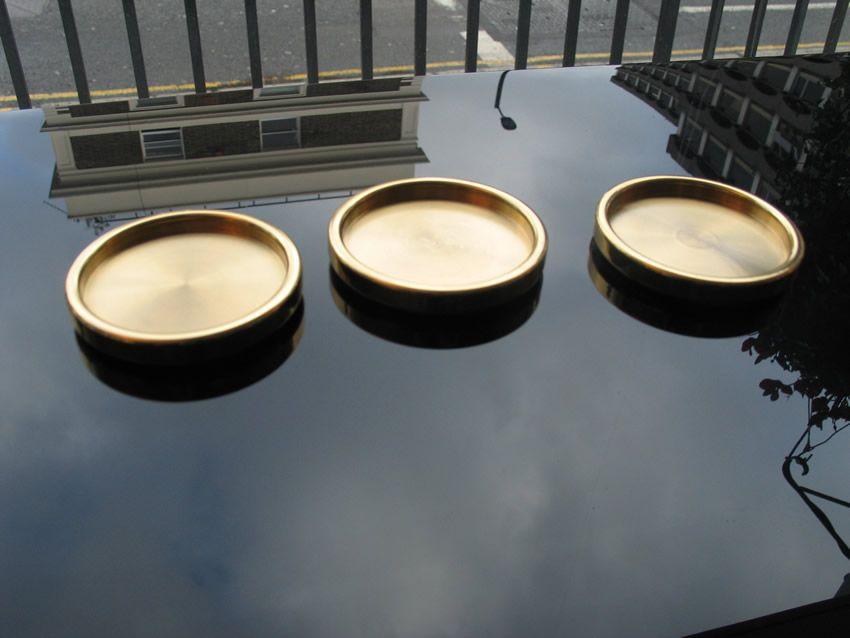 Small brass castor cups