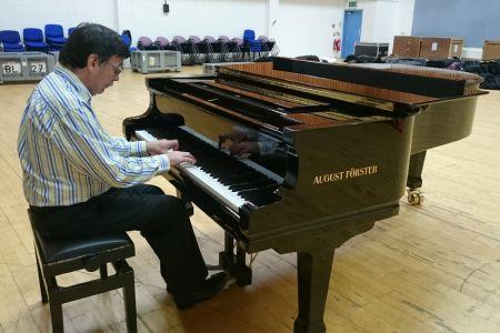 Derek Clark at the piano